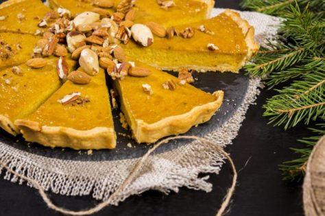 American pumpkin pie decorated with assorted nuts